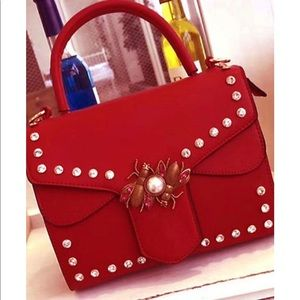 Red crossbody bag with detachable strap